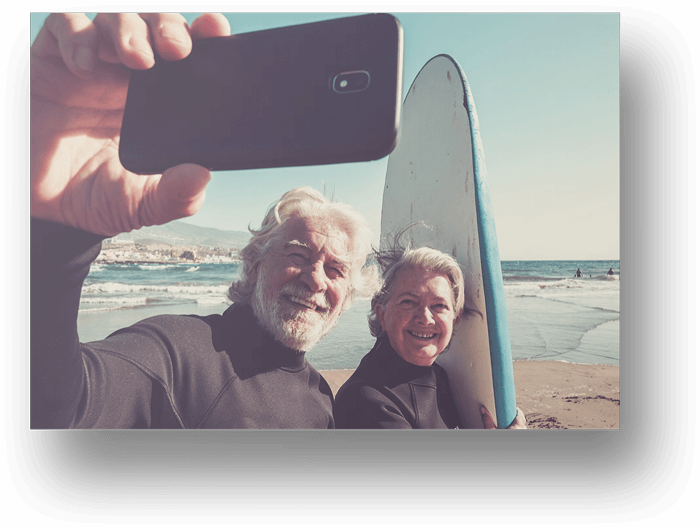 Older-Couple-Taking-Selfie-Surf-Board